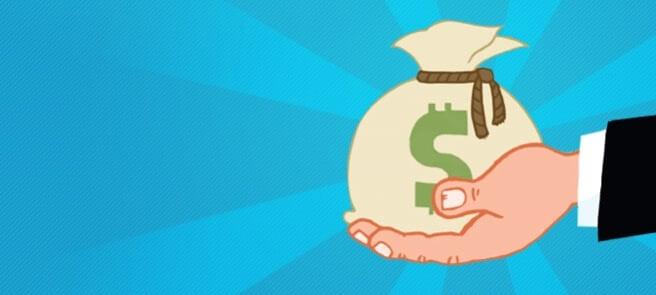 påse med pengar i hand
